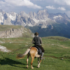 rider overlooking mountain view horse riding holiday italy by globetrotting