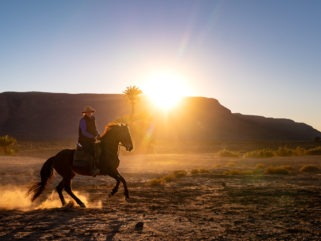 horse riding desert at sunset holiday morocco by globetrotting