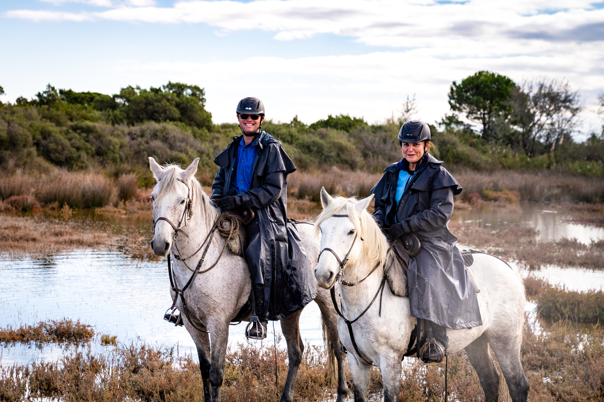 riders wearing rainproof jacket Globetrotting horse riding holidays