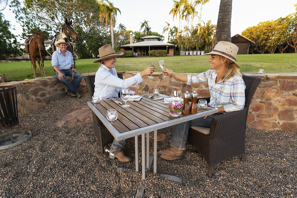 guests drinking wine at el questro homestead on kimberley ride horse riding holiday by globetrotting