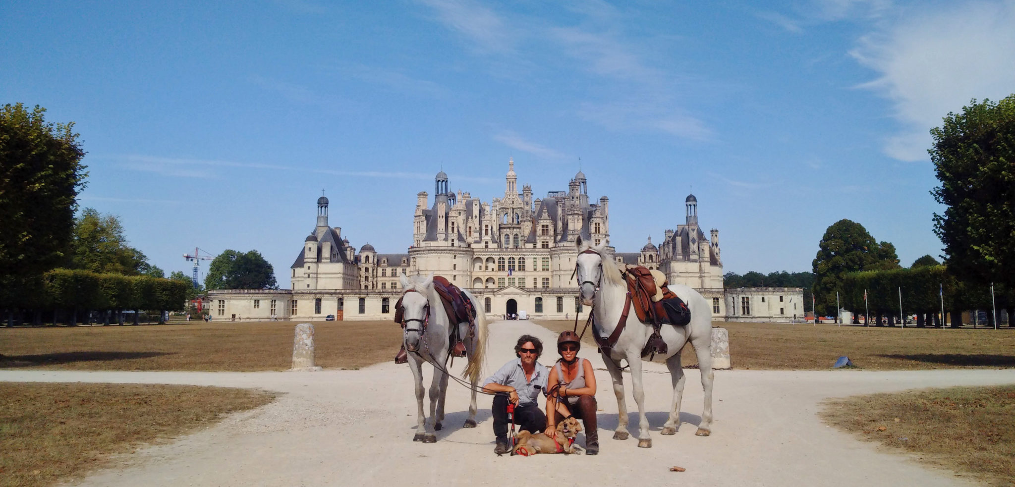 horses and riding in front of french castle horse riding holiday by globetrotting