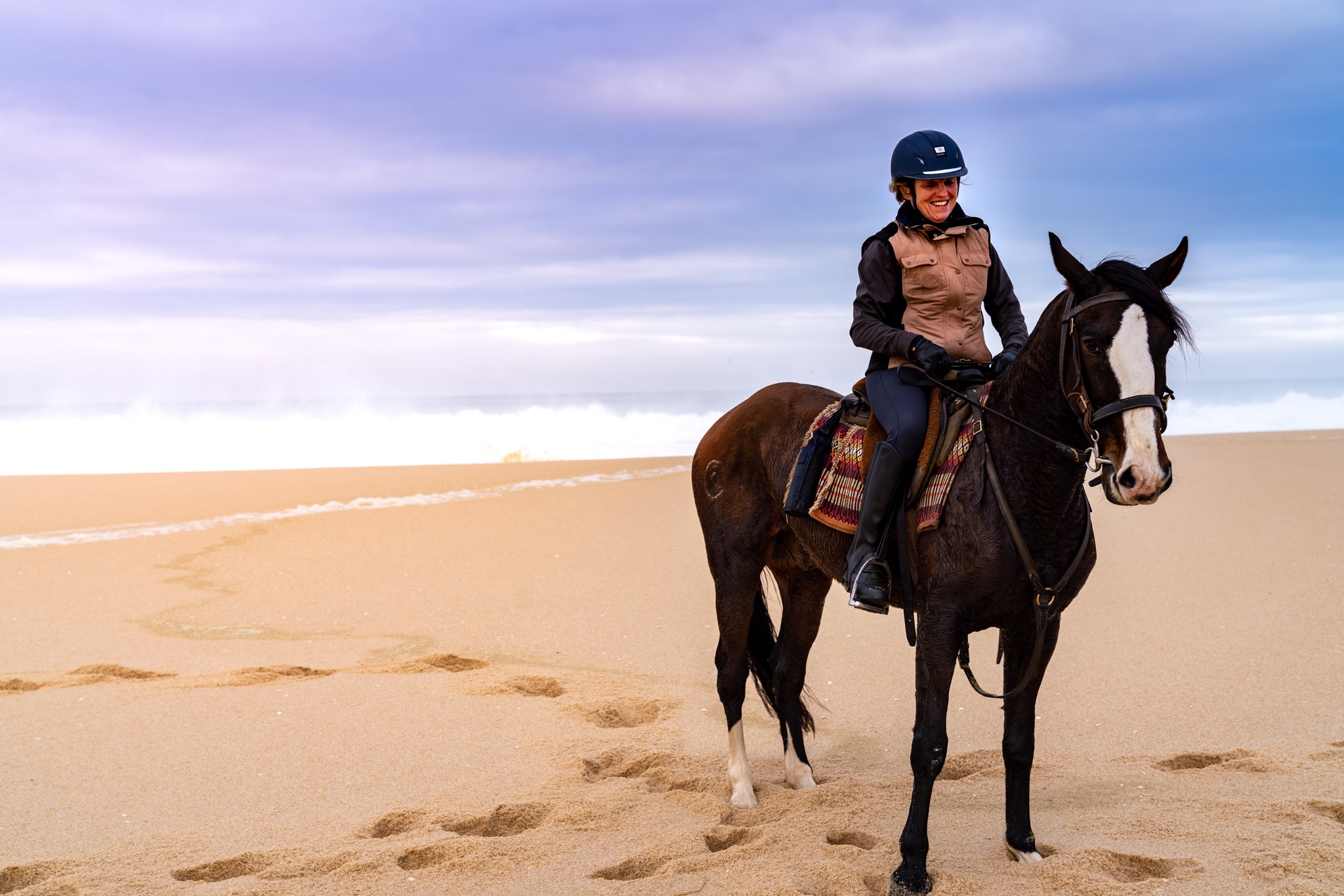 horse and rider on beach with dunes riding holiday portugal by globetrotting