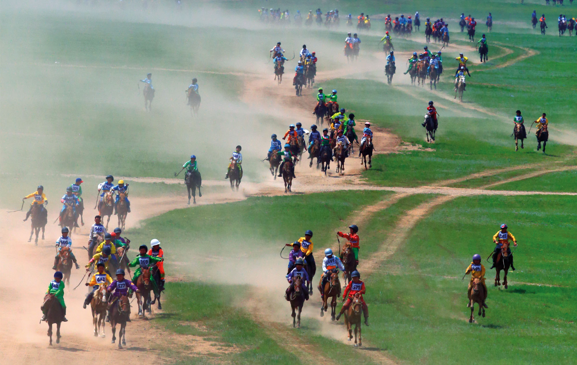 riders racing in mongolia horse riding holiday by globetrotting