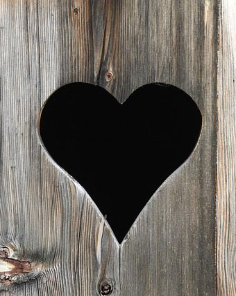 heart shaped hole on wooden door