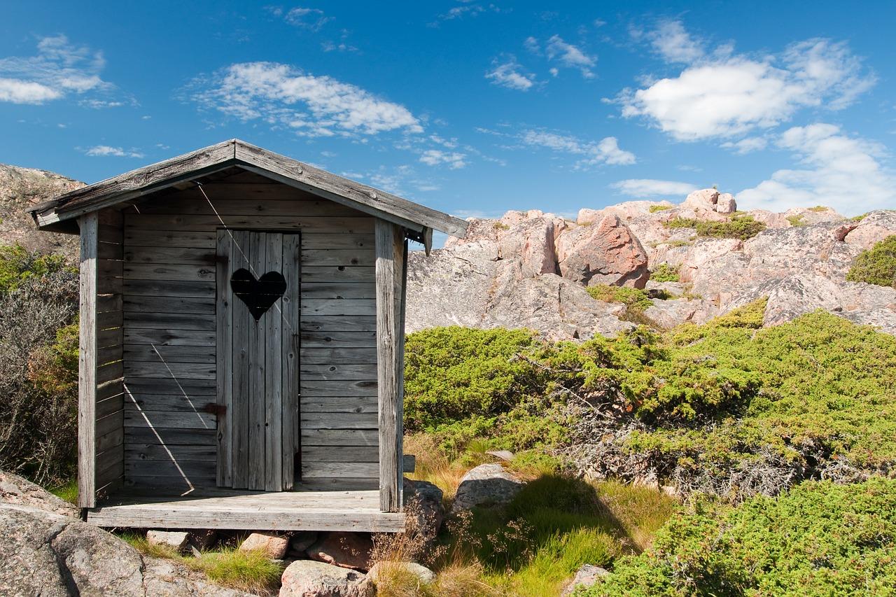 rustic toilet hut on mountain