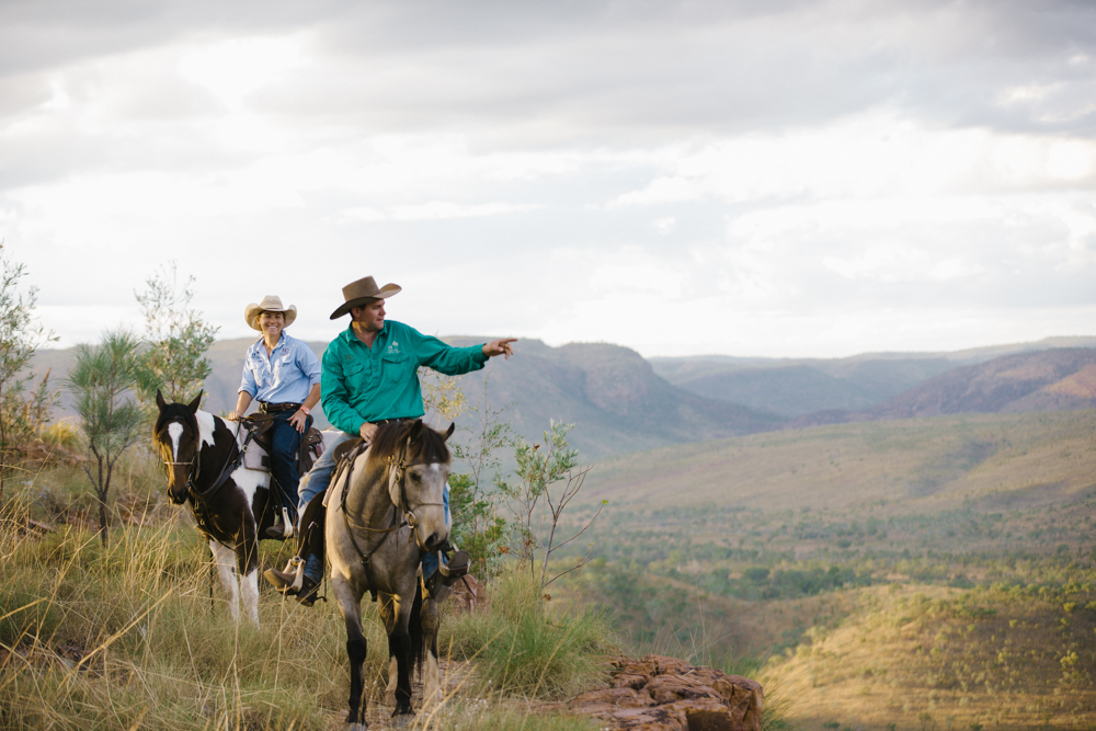 guides on horseback on mountain overlooking canyon valley on horse riding holiday the Kimberleys by Globetrotting