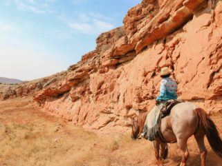 rider in canyon on horse riding holiday Wyoming by globetrotting