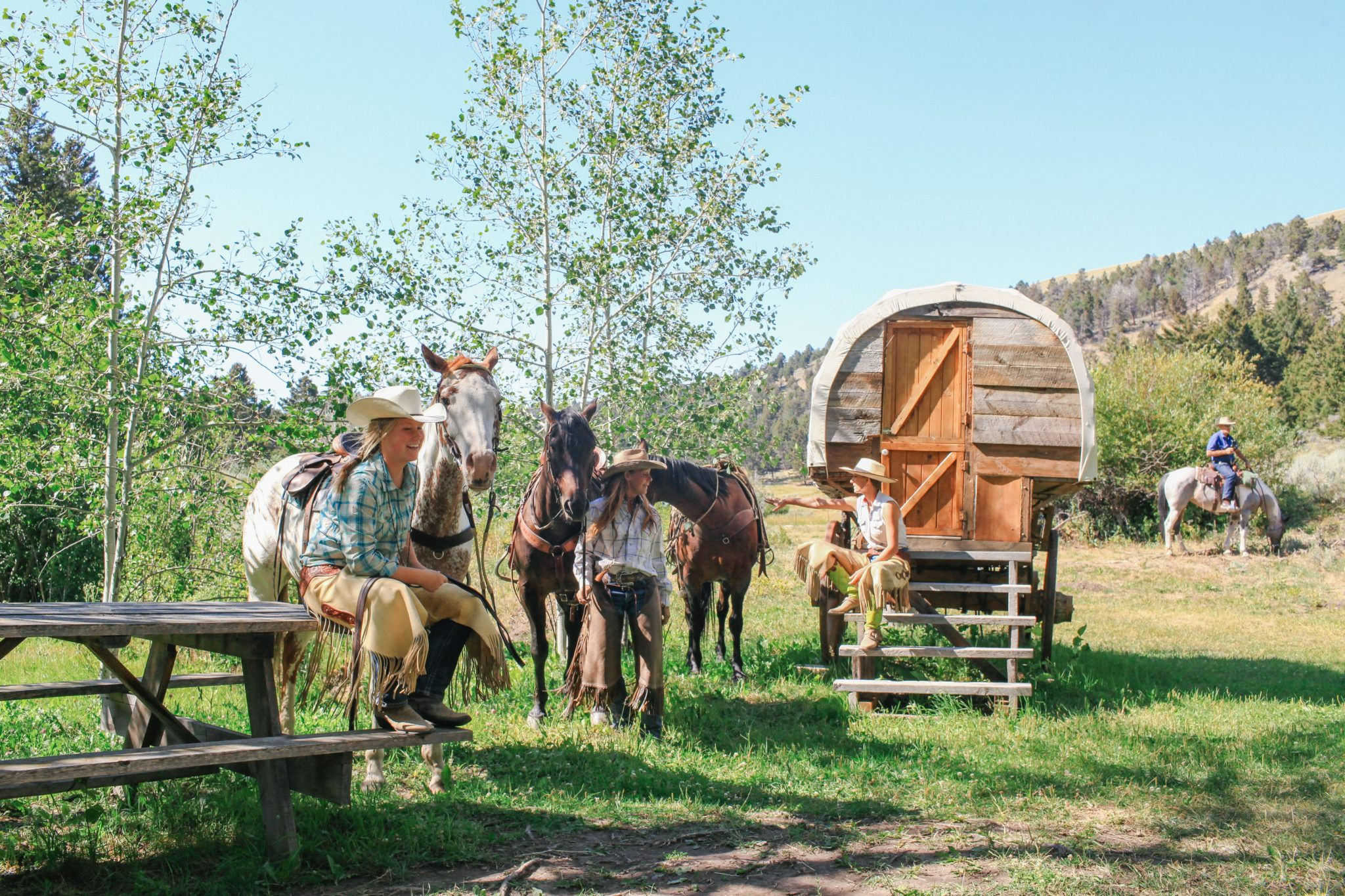 cowboy riders on horse riding holiday Montana USA by globetrotting