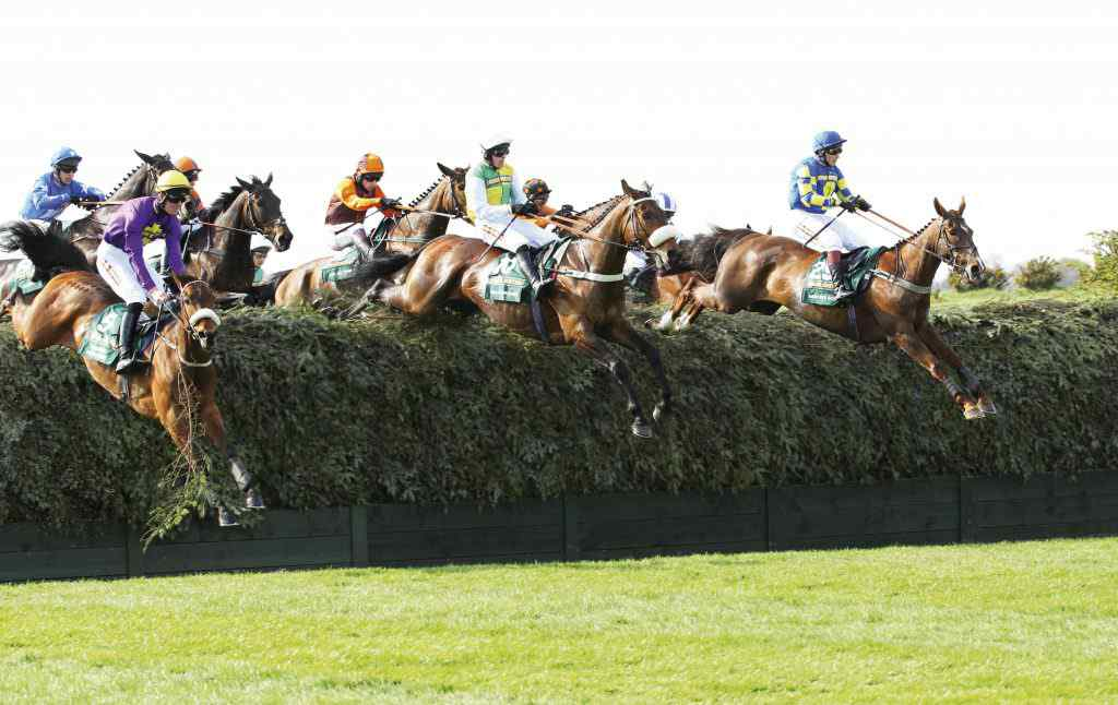 "Aintree 09.04.2011 The John Smith's Grand National Steeple Chase. Ballabriggs jumps Bechers Brook, with  No. 29, SANTA'S SON (Jamie Moore) Winner:Ballabriggs. Jockey:Jason Maguire, Trainer:Donald McCain. PIC: Matthew Webb Racingfotos.com THIS IMAGE IS SOURCED FROM AND MUST BE BYLINED""RACINGFOTOS.COM"""